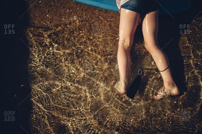 Child's legs in ocean water