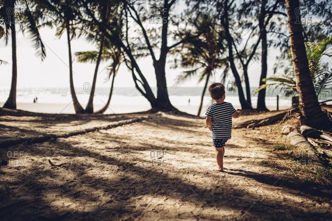 Boy in shaded beach area