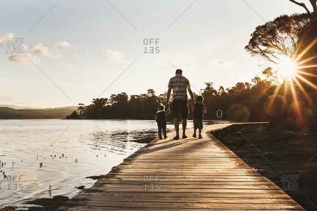 Man and boys on beach trail