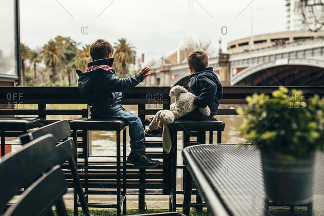 Boys together on restaurant deck