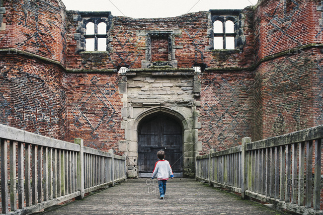 Boy by castle ruins