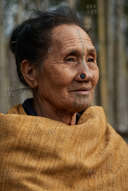 Arunachal pradesh, India - January 30, 2016: Portrait of an Apatani woman with traditional bamboo discs in her nose