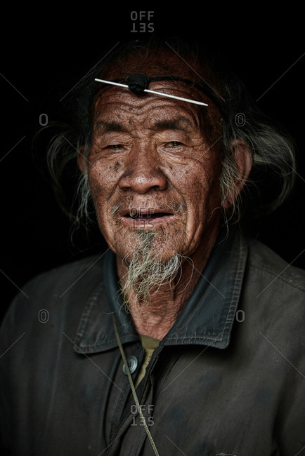 Arunachal pradesh, India - January 30, 2016: Portrait of an Apatani man against a dark background