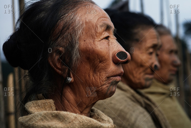 Arunachal pradesh, India - February 1, 2016: Portrait of a group of Apatani women with traditional bamboo discs in their noses