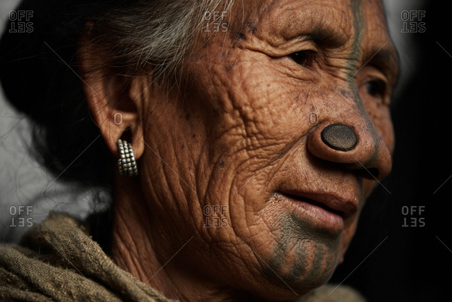 Arunachal pradesh, India - February 1, 2016: Portrait of an Apatani woman with traditional bamboo discs in her nose