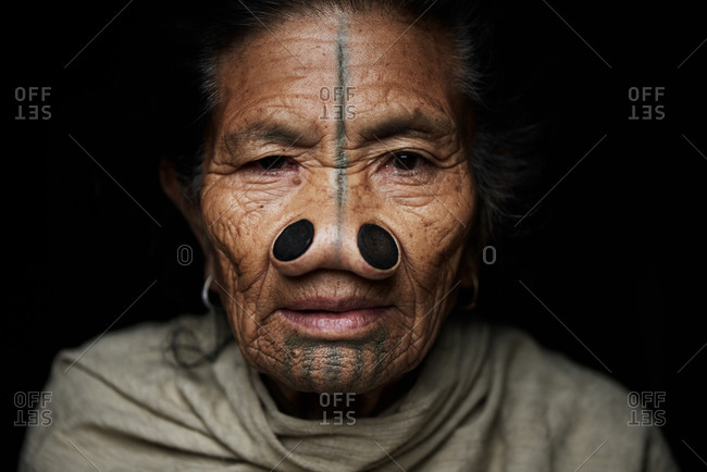 Arunachal pradesh, India - January 31, 2016: Portrait of an Apatani woman with traditional bamboo discs in her nose