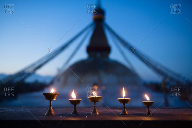 Candles lit before Boudhanath in Kathmandu, Nepal