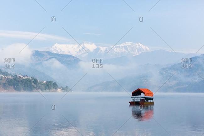 Tented pontoon boat on Begnas Lake in Nepal