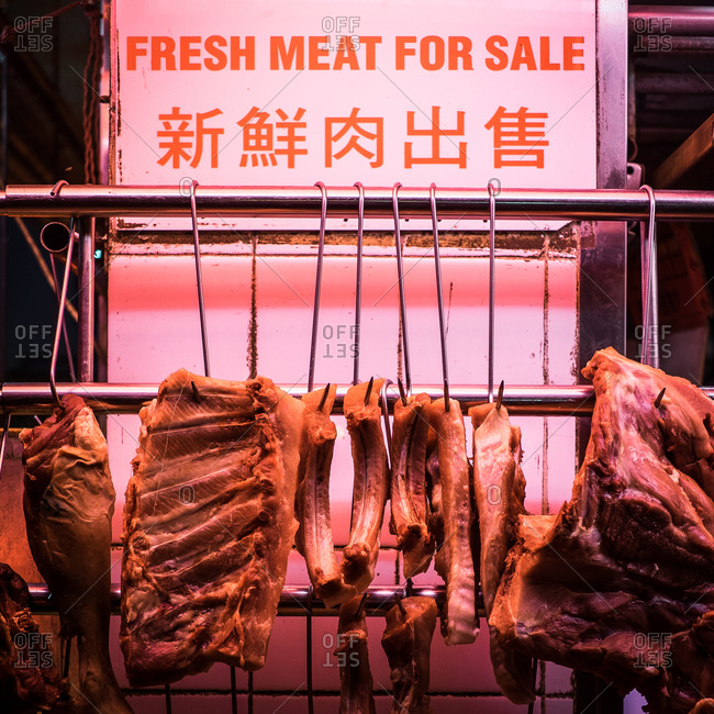 Meat for sale under heat lamps in Asian market