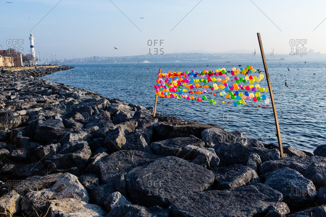 Colorful balloons on jetty in near Ahirkapi Lighthouse, Istanbul, Turkey