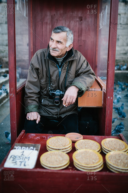 Istanbul, Turkey - January 12, 2014: Portrait of a vendor selling his wares, Istanbul, Turkey