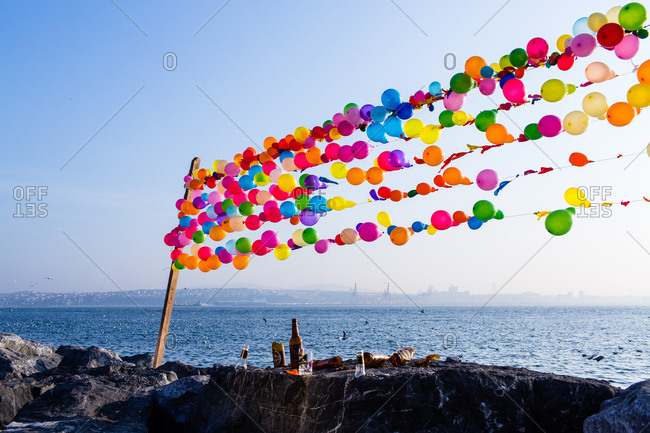 Istanbul, Turkey - January 12, 2014: Balloons and bottles of alcohol on jetty in Istanbul, Turkey