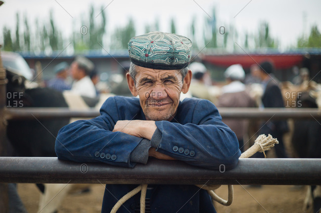 Kashgar, China - May 10, 2015: Portrait of a man at cattle auction in Kashgar