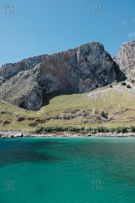 Rocky cliffs above blue-green ocean in Sicily