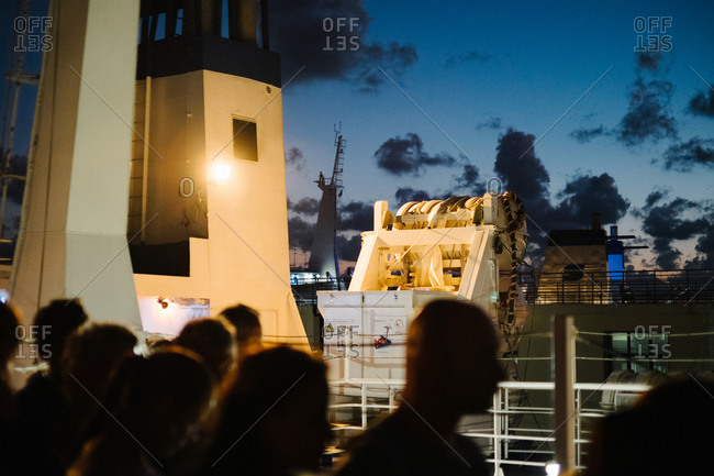 People aboard a passenger ferry at night, Italy