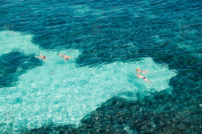 People snorkeling in the sea, Italy