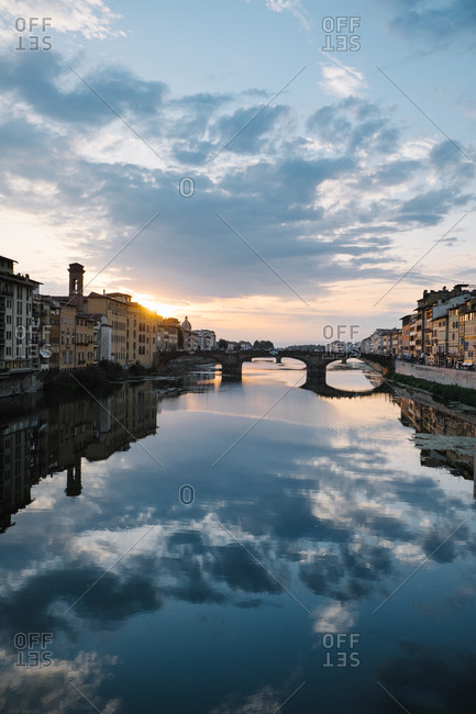 Bridge over the Arno River at sunset in Florence, Italy