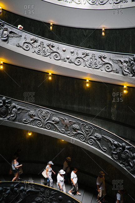 Vatican City - August 27, 2015: Visitors on the spiral stairs at the Vatican Museums, Italy