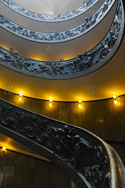 Vatican City - August 27, 2015: Ornately decorated spiral staircase at Vatican Museums, Vatican City