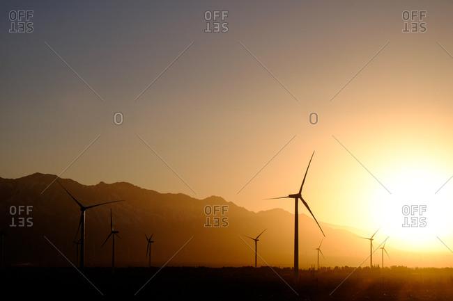 Windmill electricity generators on a wind farm at dusk