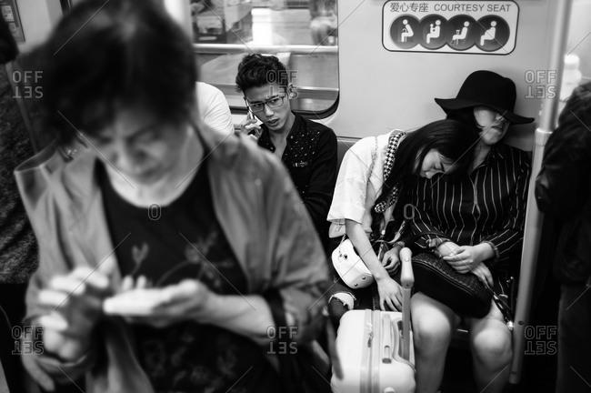Shanghai, China - October 6, 2015: People on subway in Shanghai, China