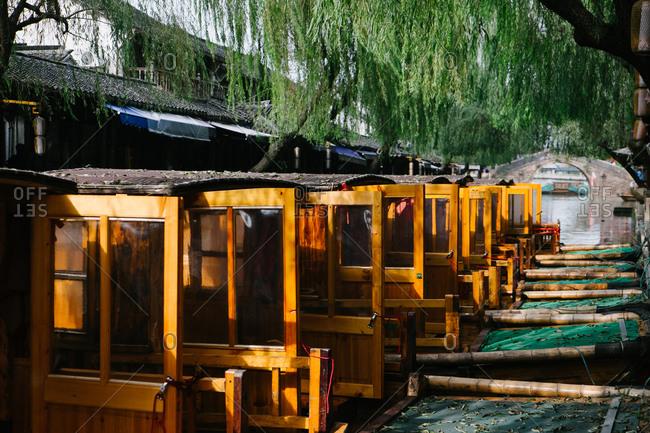 Row of boats docked in river, Zhouzhuang, China