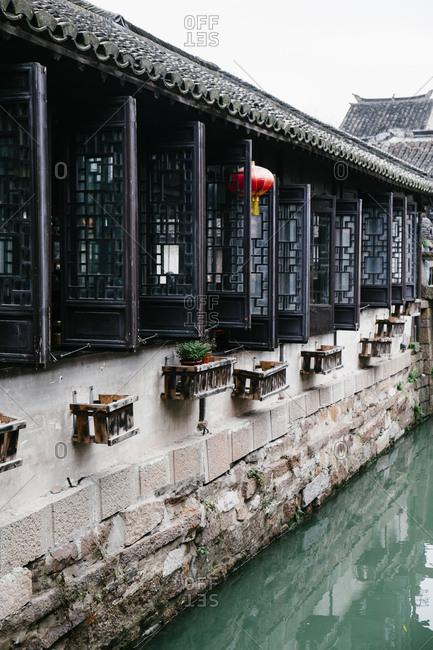 Windows of building along canal in Zhouzhuang, China