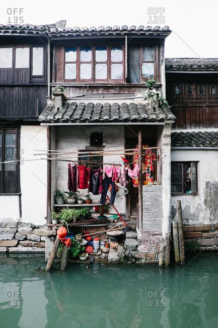 Laundry hanging on the back of a canal side home in Zhouzhuang, China