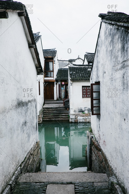ZhouZhuang, China - December 1, 2015: View of steps between homes to canal in Zhouzhuang, China