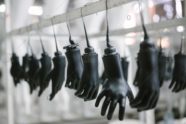 Mannequin hands dangle in factory