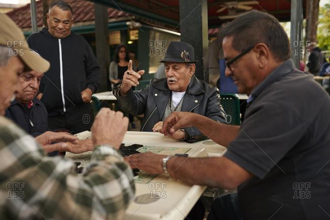 12/12/2014, Miami, Florida, USA: Men play dominoes in Miami