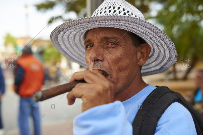 12/12/2014, Miami, Florida, USA: Cubans with straw hat smoking a cigar