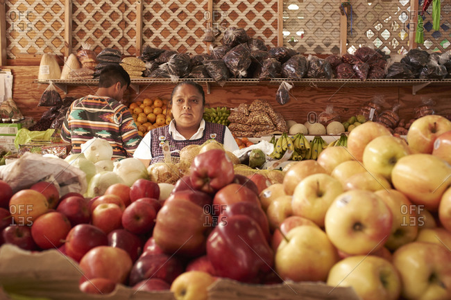 12.13.2014, Miami, Florida, USA: Fruit seller behind apples
