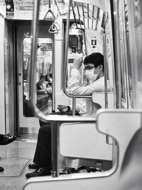 07.25.2013, : Man with surgical mask in the Tokyo subway