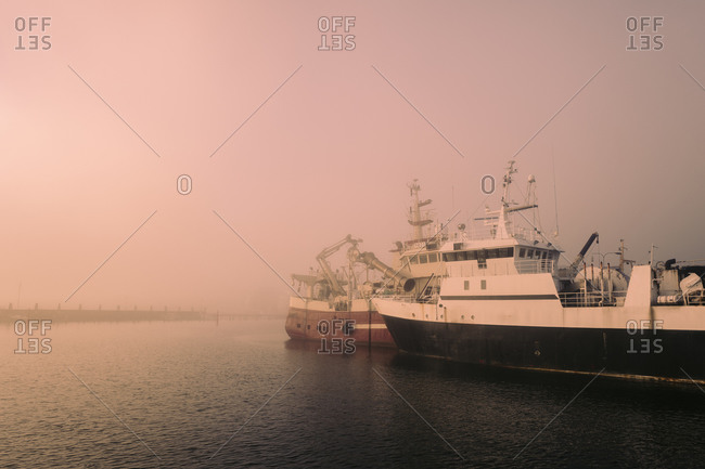 Ships in a foggy harbor in Sweden