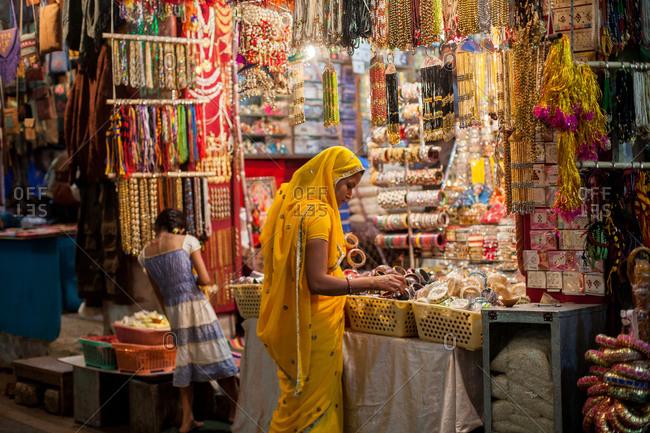 November 11, 2015: Woman looking at trinkets, India