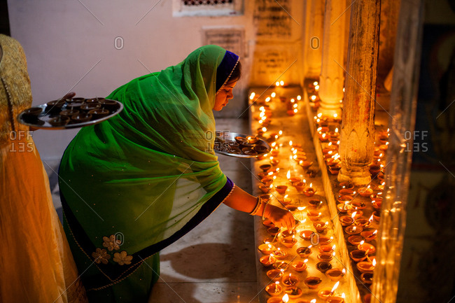 November 11, 2015: Women lighting religious candles