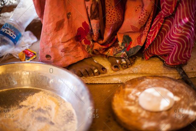 November 14, 2015: Woman's feet by dough ingredients