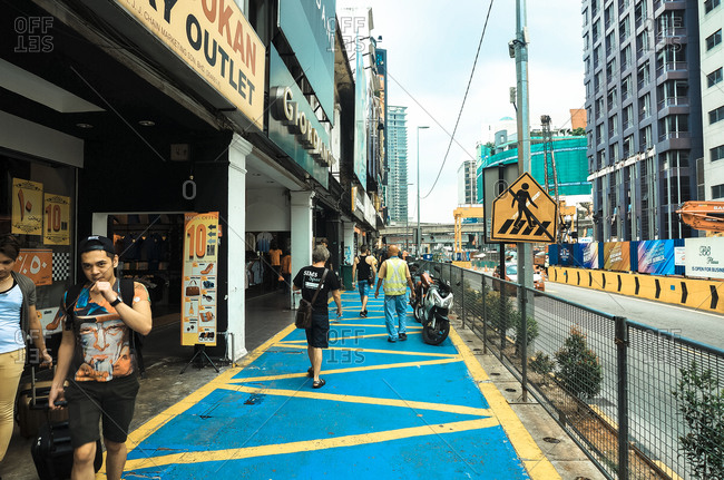 April 24, 2015: People walking Kuala Lumpur street