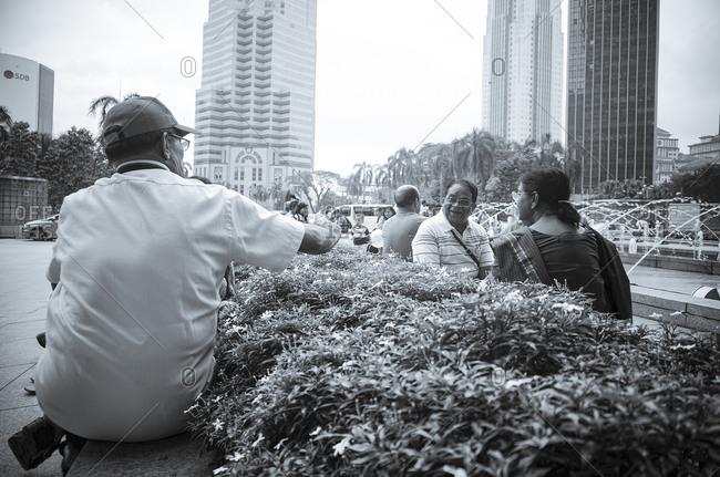April 24, 2015: People in Kuala Lumpur park