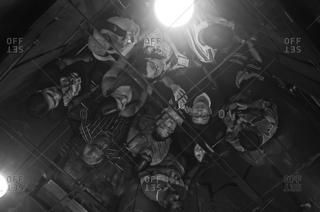April 25, 2015: People reflected in elevator ceiling