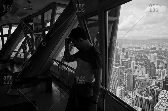 April 25, 2015: Man in viewing tower, Kuala Lumpur