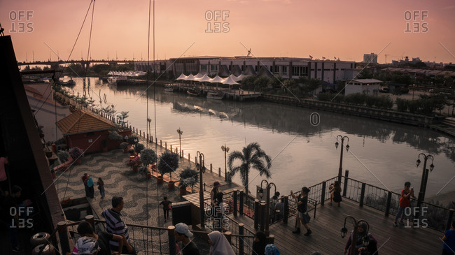 December 19, 2015: People at waterfront, Malacca, Malaysia