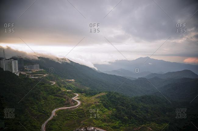 Road winding up lush mountain