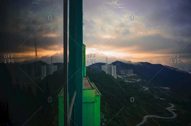 Building reflecting lush mountain