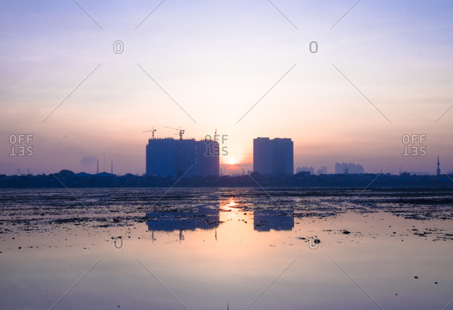 Buildings reflected in a lake