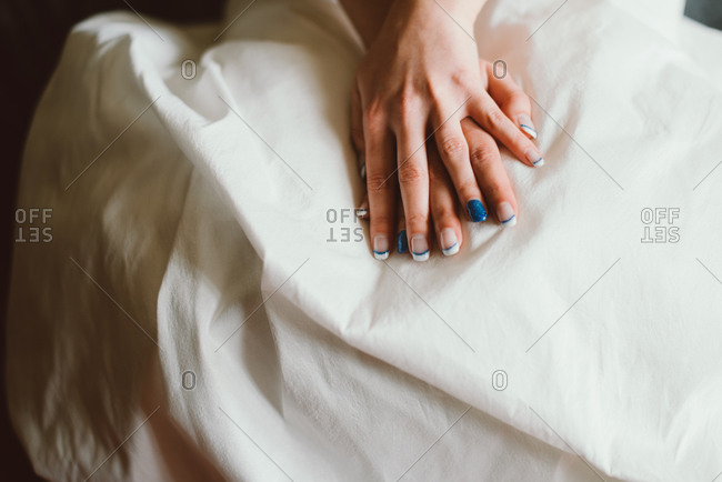 Bride with blue nail and white nail polish
