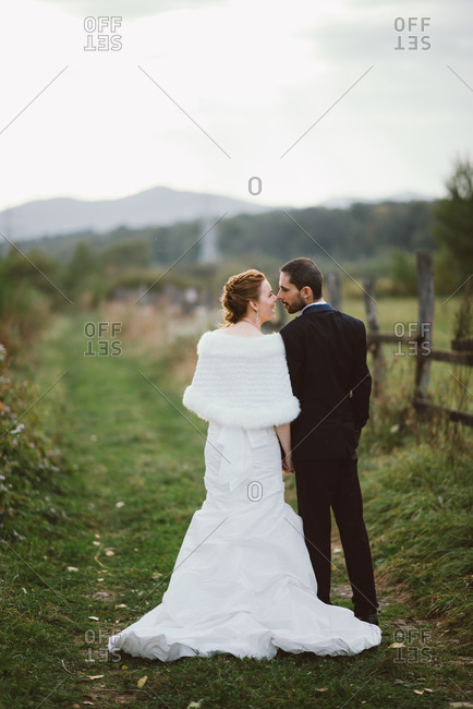 Portrait of bride and groom sharing an intimate moment