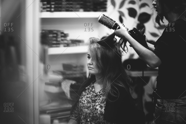 A stylist fixes bride's hair