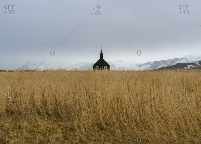 View of a country church in a field of grass in Iceland